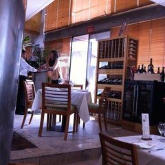 Photo taken at Viña Gourmet by Enrique S. on 5/25/2012