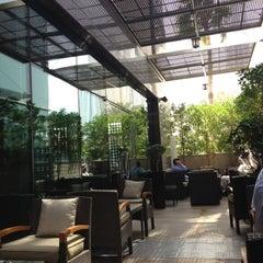 Photo taken at ICON Bar & Lounge by Scott W. on 3/13/2012