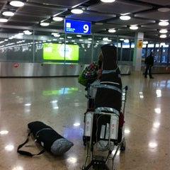 Photo taken at GVA Arrival Hall by Jose Elias A. on 4/7/2012