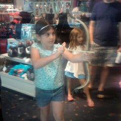 Photo taken at Disney Store by Jessica D. on 7/21/2012
