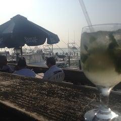 Photo taken at Oakland's Restaurant & Marina by Eva L. on 5/27/2012
