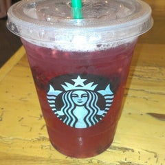 Photo taken at Starbucks by Meerim T. on 7/13/2012