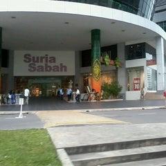 Photo taken at Suria Sabah Shopping Mall by Noni J. on 7/24/2012