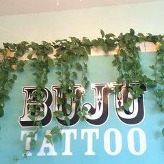 Photo taken at Buju Tattoo by Lauren P. on 6/7/2012