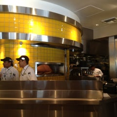 Photo taken at California Pizza Kitchen by Samuel T. on 7/18/2012
