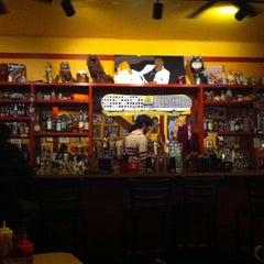 Photo taken at Dirty Frank's Hot Dog Palace by Christina B. on 2/21/2012