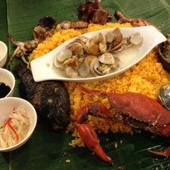 Photo taken at Blackbeard's Seafood Island by Yax C. on 8/4/2012