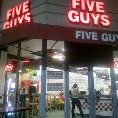 Photo taken at Five Guys by Simon O. on 7/29/2012
