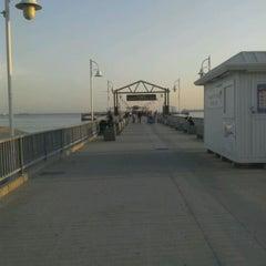 Photo taken at Belmont Veterans Memorial Pier by Charles P. on 4/9/2012