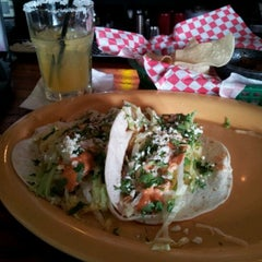 Photo taken at Tin Roof Cantina by Gloria L. on 6/20/2012