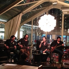 Photo taken at The House Café by Ertan U. on 2/26/2012