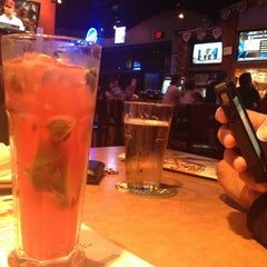 Photo taken at Boston's Restaurant & Sports Bar by Mariana R. on 7/23/2012