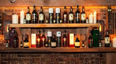 Photo of Cocktail Bar The Dead Rabbit at 30 Water St, New York, NY 10004, United States