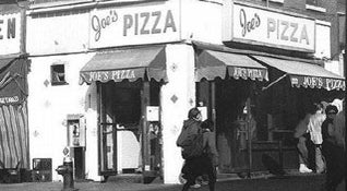 Photo of Italian Restaurant Joe's Pizza at 7 Carmine St, New York, NY 10014, United States