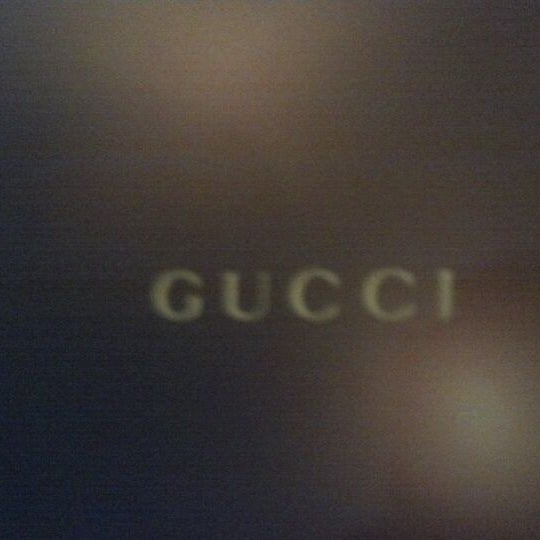 Photo taken at Gucci by Dre on 12/24/2011
