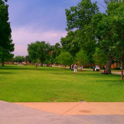 Photo taken at South Oval by Nicole P. on 5/4/2012