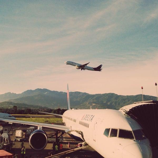 Photo taken at Gate 5 Aeropuerto Internacional Juan Santamaria by S.B. R. on 8/28/2015