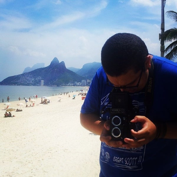Photo taken at Praia de Ipanema by Phelipe Paraense F. on 3/14/2014