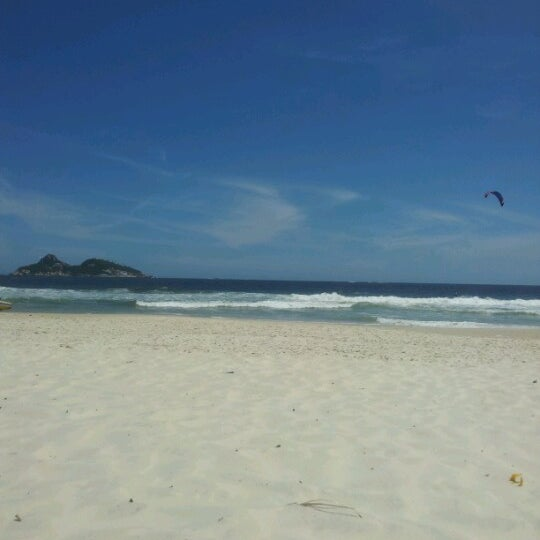 Photo taken at Praia da Barra da Tijuca by Edmar A. on 11/30/2012