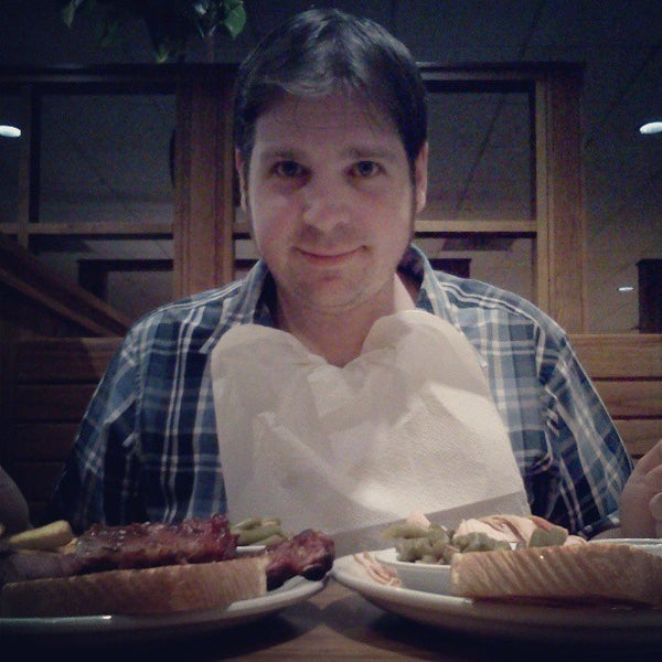 Photo taken at Oakwood Smokehouse & Grill by Jamie P. on 3/24/2013