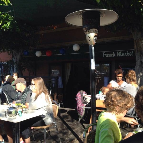 Photo taken at French Market Café by Olesya S. on 11/2/2014