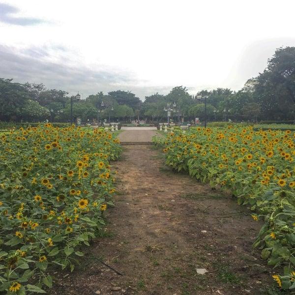Photo taken at Queen Sirikit Park by Joy N. on 12/17/2016