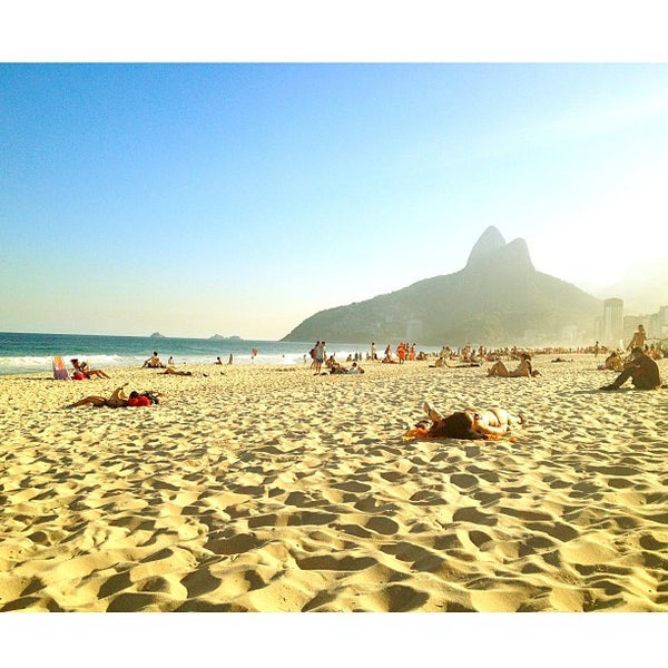 Photo taken at Praia de Ipanema by Heron M. on 7/12/2013