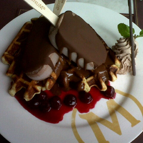 Photo taken at The New Magnum Café by Dhezz L. on 2/2/2013