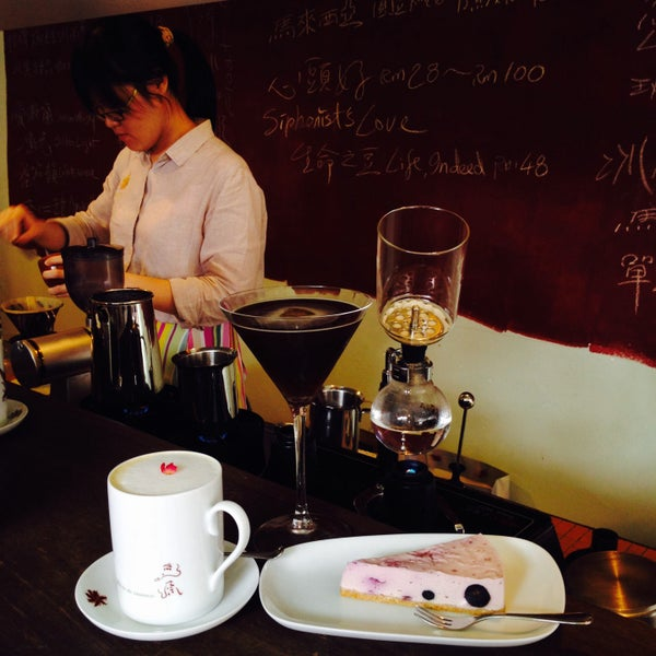 Photo taken at Typica Café by Xiao H. on 2/14/2015