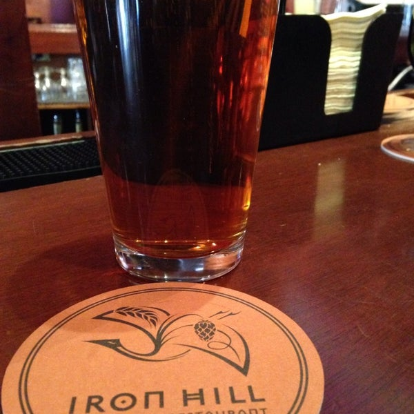 Photo taken at Iron Hill Brewery & Restaurant by Kathleen C. on 3/8/2014