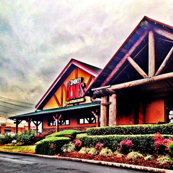 Photo taken at Smokey Bones Bar & Fire Grill by Greensboro, NC (@greensboro_nc) on 2/5/2013
