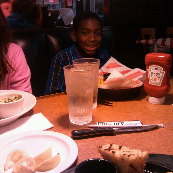 Photo taken at TGI Fridays by DeeDee B. on 3/28/2013