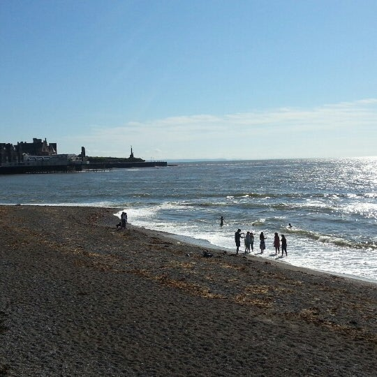 Photo taken at Aberystwyth Beach by Martin P. on 8/16/2013