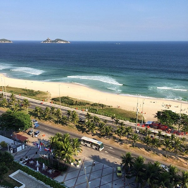 Photo taken at Praia da Barra da Tijuca by Jamison N. on 4/11/2014