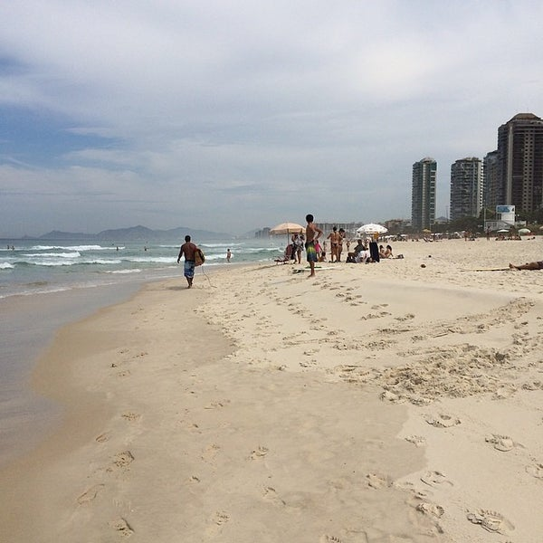 Photo taken at Praia da Barra da Tijuca by Jamison N. on 4/13/2014