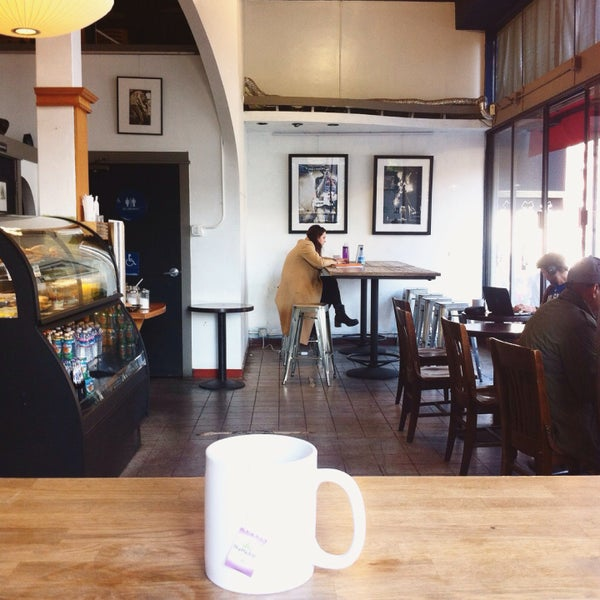 Photo taken at Cup-A-Joe Coffee House by Turker O. on 5/7/2015