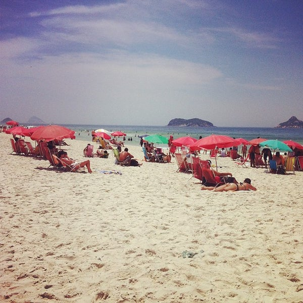Photo taken at Praia da Barra da Tijuca by Sara A. on 1/1/2013