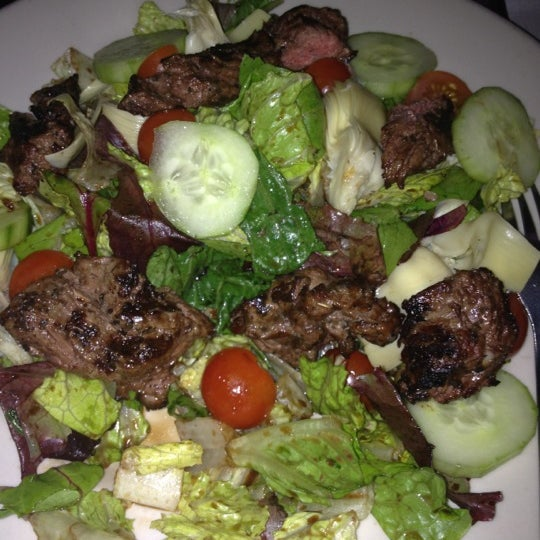 House salad comes standard with artichoke hearts! Not to be missed