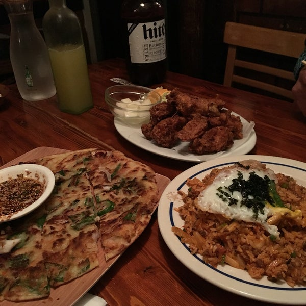 order the kimchi fried rice, seafood pancake, and chicken wings. pair it all with a large hite and a pineapple soju and it's the perfect meal.