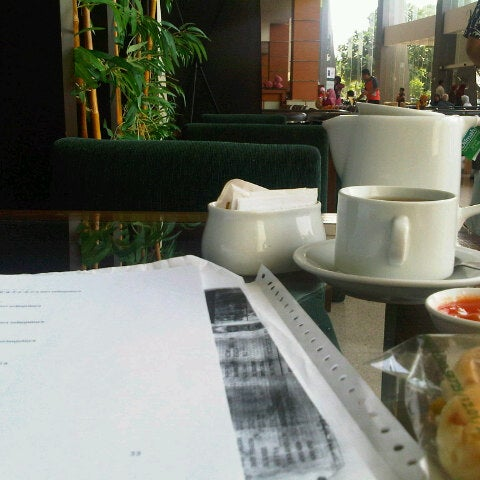 Photo taken at Parsley Bakery & Cake Shop by tia m. on 12/11/2012