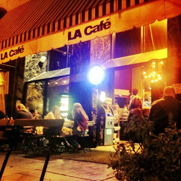 Photo taken at LA Café by Emerson Q. on 8/18/2013