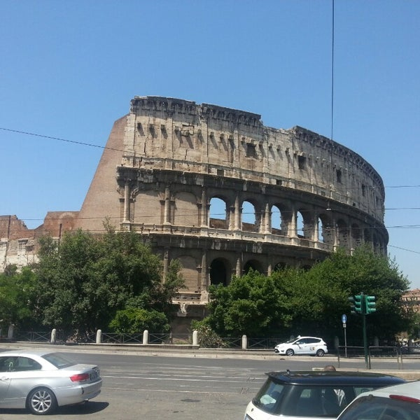 Photo taken at Piazza del Colosseo by David B. on 6/20/2013