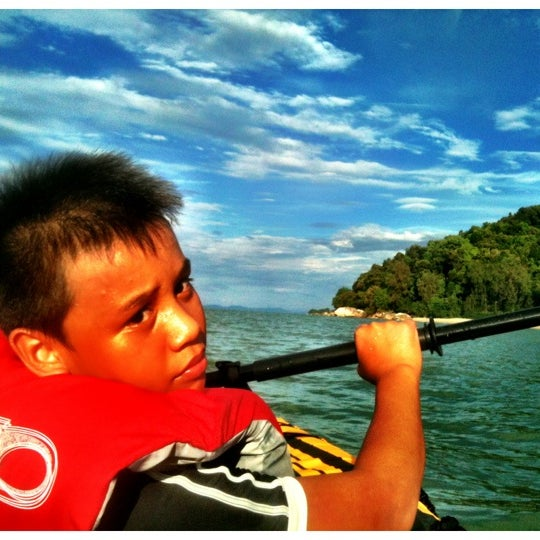 Photo taken at Teluk Bahang Beach by Dave R. on 12/17/2012