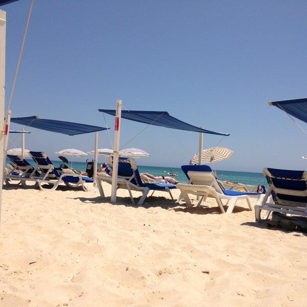 Photo taken at Praia do Barril by Tim I. on 7/18/2013