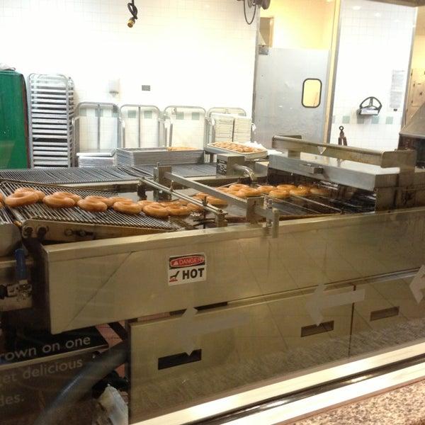 Photo taken at Krispy Kreme Doughnuts by TJ on 3/13/2013