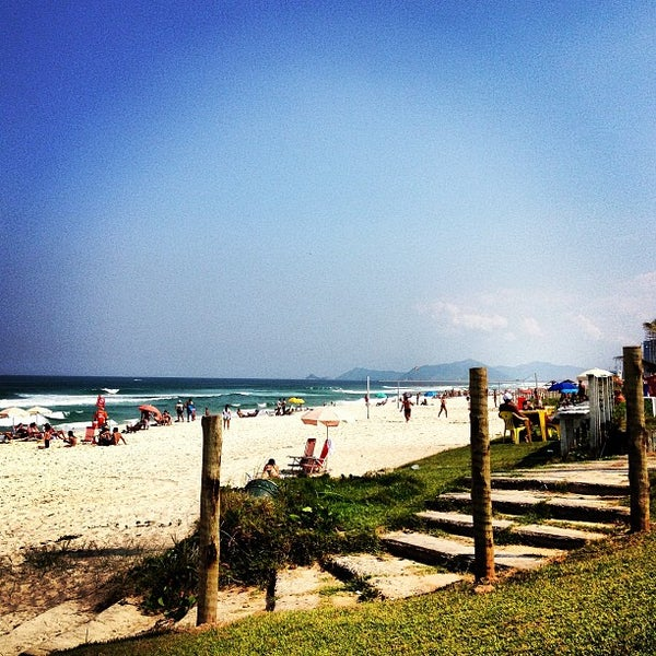 Photo taken at Praia da Barra da Tijuca by Beta B. on 4/28/2013