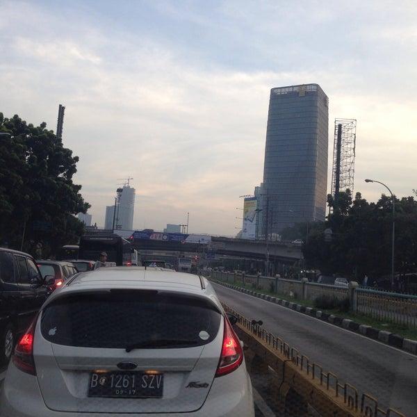 Photo taken at Perempatan Kuningan (Traffic Light) by Rika D. on 2/25/2015