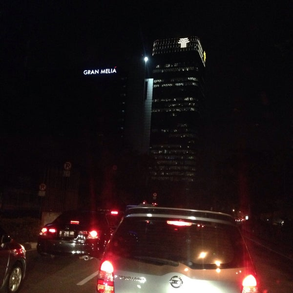 Photo taken at Perempatan Kuningan (Traffic Light) by Rika D. on 3/30/2015