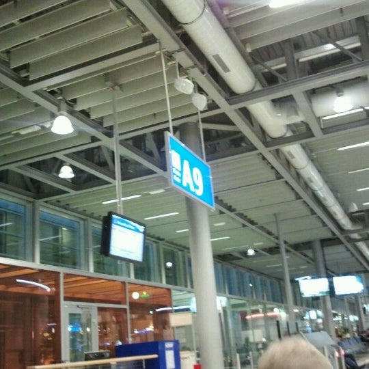 Photo taken at Gate A9 by Teresa A. on 11/27/2012
