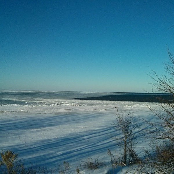Photo taken at Durand Eastman Beach by Mike J. on 3/6/2014
